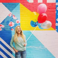 Lifestyle entrepreneur photo shoot in Dallas by Caroline White Photography - of fellow Bschooler from Marie Forleo's B-School, Lindsay Mills-Steffe.  Fun colorful balloons against a bright painted brick wall can make for some happy branding!!