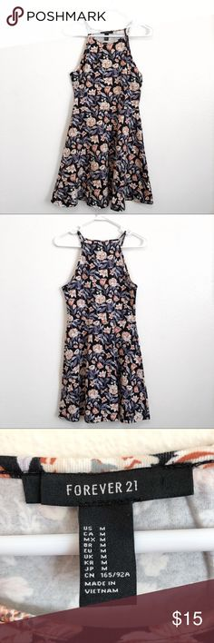 NWOT Floral skater dress Floral skater dress in a size medium from forever 21. Has a high neck design and a flared skirt. This is brand new and has never been worn! Forever 21 Dresses Mini