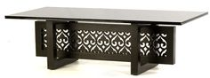 here the traditional style of jalli cutwork is used in a contemporary fusion table