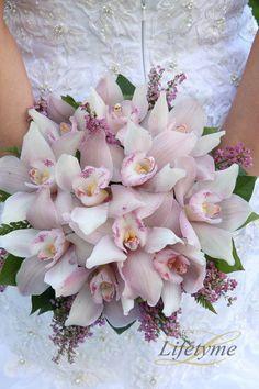 LPV Wedding: Elyse and Israel #orchid #weddingbouquet #purplebouquet