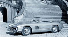 """By the late 1950s, open-top two-seaters were so popular that Mercedes-Benz decided to convert the 300 SL (W 198). In spring 1957 the legendary """"Gullwing"""" was succeeded by the 300 SL Roadster, thus bringing the thrill of open-top driving to the range of high performance sports cars"""