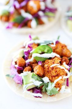 Roasted Cauliflower and Chickpea Tacos Recipe on twopeasandtheirpod.com