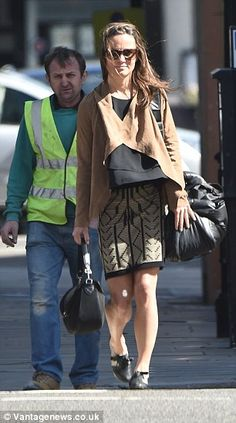 Pretty chic: Miss Middleton opted for a low-key ensemble of a suede jacket and short embro...