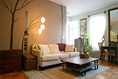 #Nature inspired #livingroom with #wall_decor and #wooden #furniture