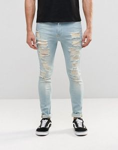ASOS Super Skinny Jeans With Extreme Rips In Mid Wash Blue