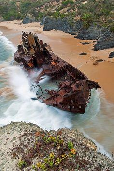 Beached ship at Vila Nova de Milfontes, a landmark in southwest Portuguese coast. Now popular with tourists.