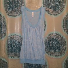 Super cute light blue zebra stripe shirt Light blue zebra striped shirt. Stripes are see through by design. Perfect for summer. Xhilaration Tops Tank Tops
