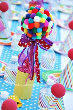 Fun rainbow centerpieces at a girl Birthday Party just using pom poms! So easy, fun and cute!