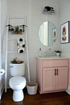 S y#Bathroom #rustic #modern, #homedecor sink, cabinet, pink cabinet, diy decor, #ladder #Plants, wall art, #homedecor farmhouse, wicker trash can, woven trash can, mirror, #bathroomlight #diy #diydecor #afflink