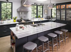 Strata Olympico by CustomCraft Countertops® adds contrast and dimension to any kitchen