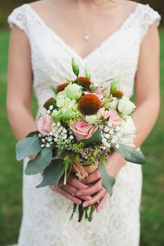 bouquet with eucalyptus, photo by Colagrossi Studios http://ruffledblog.com/winona-lake-elopement #weddingbouquet #flowers