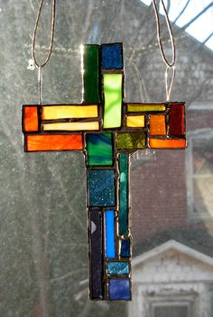a Patchwork Wernersville Cross in rainbow colors by Stratozpheres (also of Nutmeg Designs) $79.00
