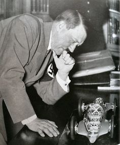 "Great view of Hitler's hand and cuff links. He was a complete auto freak, knew engines, horsepower and other intricacies of Mercedes vehicles. He called BMW's ""junk"" when Speer chose to drive one, but never told that to Speer's face. (via putschgirl) Albert Pike, German Soldiers Ww2, Germany Ww2, Bmw S, The Third Reich, Heavy Metal, Luftwaffe, Rare Photos, World History"