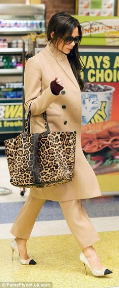 Victoria Beckham wearing camel coat and matching ankle trousers