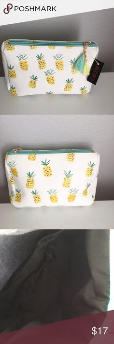 Pineapple  Cosmetic Bag/Pouch Cute vynil Cosmetic bag/pouch featuring pineapples Top zip closure Interior : black fabric  lining Bags Cosmetic Bags & Cases