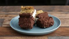 Recipe with video instructions: How to make chocolate dipped ice cream cookie sandwich! Ingredients: 4 cups vanilla ice cream, slightly melted, 2 cups bittersweet chocolate chips, ½ cup puffed rice, For the chocolate chip cookies:, 1 cup all-purpose flour, ½ tsp baking soda, ½ tsp salt, ⅓ cup butter, melted, ½ cup light brown sugar, ⅓ cup sugar, 1 egg, ½ tsp vanilla, ¾ cup semi-sweet chocolate chips