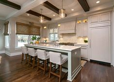 Coastal Kitchen Design. This coastal kitchen is very inspiring. Wall Paint Color: Sherwin Williams DCR102 Quill #Coastal #KitchenDesign #CoastalKitchen