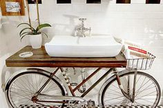 LOVE this post on using a bicycle to make a bathroom sink renovation.  Has other recycle ideas for home decor too.
