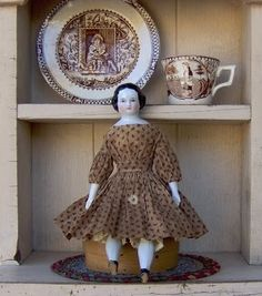 Perfect! Child's Brown transferware plate and mug and a lovely china head doll.