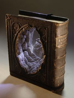 Carved book sculptures  by Guy Laramee
