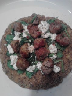 Flaxseed wrap from Wheat Belly book with sausage, spinach, and feta