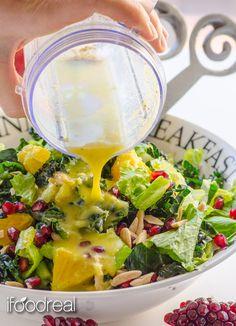"Winter Fruit Kale Salad with Orange Ginger Dressing - Raw kale salad with pomegranate arils, orange slices and toasted slivered almonds, ""drowning"" in guilt-free scrumptious Orange Ginger dressing."