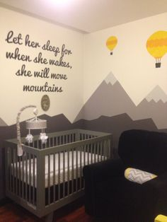Our little one's gender neutral nursery!   Grey, black, white and yellow nursery. Mountain landscape. Hot air balloons. Glider. Crib. Mid Century Modern. Mobile.
