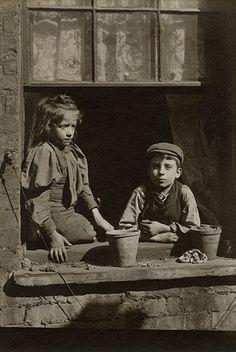 Spitalfields nippers: Boy and girl on window ledge