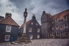 This square in Culross was painted (as were many buildings) for the Outlander TV series to give the town that old world feel. I am a little curious as to how this square looks when it is all white.