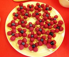 Raspberries and blueberries shaped poppys on shortbread biscuits for a poppy look.