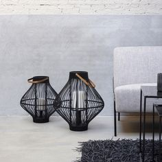 Timeless and trendy, the Tula Lantern from Pomax harkens back to the days of traditional hand-crafted ornamental pieces. Crafted from bamboo with a metal base, the central tealight is framed in a stunning, wicker-like cage.