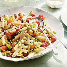 Showcase the many cherry tomatoes from your garden in Penne with Herbs, Tomatoes, and Peas.