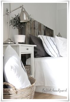 up-cycled wooden palette headboard in greige weathered finish, with crisp white accents, bedroom {via stylizimo blog}