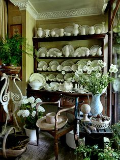 White dinnerware on shelves and crown molding