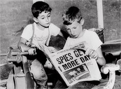 """Here are two children reading a newspaper, that happens to have """"spies get 1 more day"""" on the front cover. This image shows how popular/known spies were during this time."""