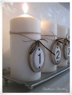 Advent Candles- use the numbers but get one large white candle for the middle, smaller pink/purple ones for the other weeks.