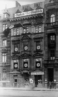 """The headquarters building of the Nazi party in Cologne at the Hohenzollen Ring 81 (1928). The sign at the top reads """"The Jews are our Misfortune""""."""