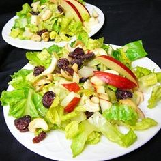 Winter Fruit Salad with Lemon Poppyseed Dressing | Apples, pears, and dried cranberries are tossed with romaine lettuce, Swiss cheese, and cashews in this winter fruit salad.
