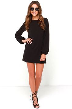 You'll be primed and ready in the Perfect Situation Black Long Sleeve Shift Dress when everything starts falling into place! This woven poly…