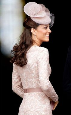 Blushingly sweet in Alexander McQueen dress and Jane Taylor chapeau.