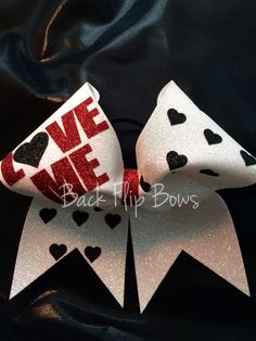 Irridescent glitter bow with glitter words and hearts!