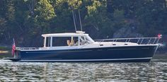 """One of the major differences between the MJM 50z and other boats in class is the open pilothouse which allows the owner and guests to be both """"inside"""", yet outside at the same time."""