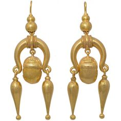 Antique Scarab Motif Gold Earrings. Victorian 15K earrings with a central scarab drop flanked by two pendeloque drops. Scarabs were regarded are sacred by the ancient Egyptians and used as a symbol of life and rebirth. With the rediscovery of Egyptian treasures in the 1900th century scarab motifs became popular in jewelry.  c 1870