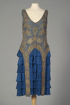 "Blue silk evening dress with gold beading from the mid-1920s (KSUM 1995.17.1765). To see this dress in person come check out our current exhibition ""Flapper Style: 1920s Fashion."""