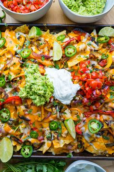 Sheet Pan Chicken Fajita Nachos Sheet Pan Chicken Fajita Nachos Sheet Pan Chicken Fajita Nachos<br> Easy chicken fajitas baked on a single sheet and then served as nachos over tortillas and smothered in melted cheese! Easy Chicken Fajitas, Chicken Nachos Recipe, Fajita Recipe, Chicken Recipes, Dairy Free Nachos Recipe, Beef Nachos, Mexican Food Recipes, Vegan Recipes, Cooking Recipes