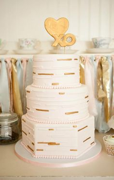 Gold Accented White Wedding Cake Photo