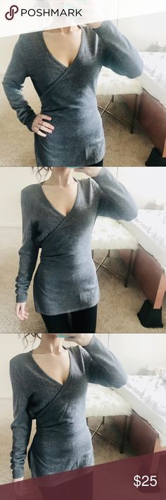 Susana Monaco wrap style top Susana Monaco faux wrap style top tie around back so it created this wrap style affect ! Has slits on side of top is a light sweater material super comfy and pretty! This very big on me only because it ties in back it's how it fit ! Susana Monaco Tops