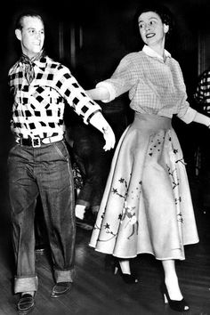 Dancing Queen (to-be): She and Prince Philip join in a square dance at a cowboy dress party during the royal tour of Canada in 1951.
