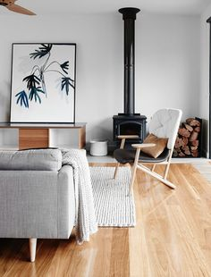 wood floor + knit rug + grey sofa + graphic print
