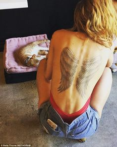 Tatt's not real!: Bella Thorneshocked fans on Friday when she shared an Instagram photo which showed a large pair of angel wings inked onto her back